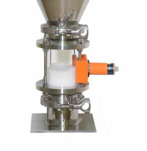 Compressed air venturi loader for plastics sensor holder